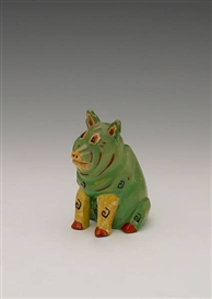 Artwork by Louis Wain, Ceramic pig, Made of bears stamp 'reg no. 638320' cubist pig with black hieroglyphs on a green and yelleow body with red details