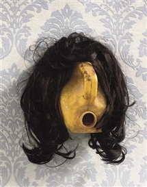 Artwork by Romuald Hazoumé, Baby Doll, Made of plastic jerry can and wig