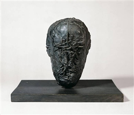 "Artwork by Michael Croissant, ""KOPF"", Made of Bronze with black patina, mounted on panel."