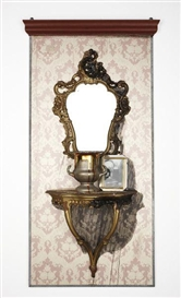 Artwork by Ed & Nancy Reddin Kienholz, Elle Mono Series #16, Made of Oil, glue, lace, wallpaper, giltwood mirror and table, black and white photograph in metal frame, silver-plate trophy cup, wooden molding and galvanized aluminum on wooden panel with chocolate candies