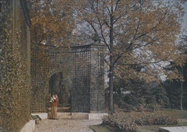 Artwork by Louis Lumière, A large autochrome depicting a woman standing with a dog in front of a great latticed gate, Made of autochrome