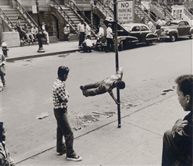 Artwork by Walter Rosenblum, Chinning on Pole, 105 St., NYC., 1952, Made of gelatin silver print