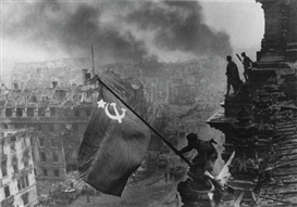 Yevgeny Khaldei, Raising the Soviet Flag over the Reichstag, Berlin (1945)
