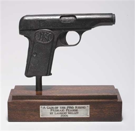 Artwork by Laurent Millet, A GUN OF THE 1916 RISING - PADRAIG PEARSE, Made of Cast bronze on a wooden base