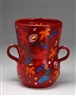 Tony Curtis, Double-handled vase with bright multicolored flowers and other forms on a red ground