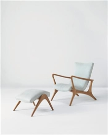 "Artwork by Vladimir Kagan, ""Contour"" lounge chair and ottoman, Made of Walnut, fabric"