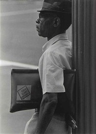 Artwork by Roy DeCarava, Untitled (Man with portfolio), Made of gelatin silver print