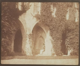 Artwork by William Henry Fox Talbot, THE ANCIENT VESTRY - THE REVEREND CALVERT R. JONES IN THE CLOISTERS, LACOCK ABBEY 1845, Made of salt print from a calotype negative