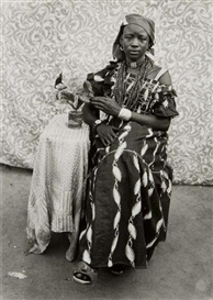 Artwork by Seydou Keïta, Untitled (Yung woman with flowers), Made of gelatin silver print