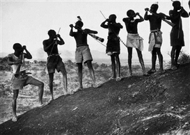 Artwork by George Rodger, Napore Hornblowers CallingTribesmen Together for a Hunt, Made of Gelatin silver print