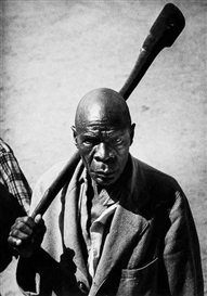 Artwork by George Rodger, The Royal Executioner of the Bunyoro Tribe, With His Symbolic Axe, Made of Gelatin silver print