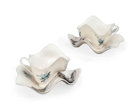 Artwork by Robert Lazzarini, Two teacups, Made of printed porcelain cup and saucer; metal tea spoon