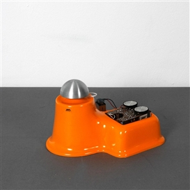 Artwork by Walter Giers, Radioburg object, Made of Orange plastic, aluminium, PCB, battery