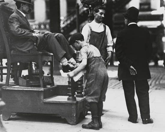 Artwork by Lewis Hine, Shoe shine boy working, Made of Silver print