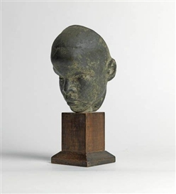 Artwork by Richmond Barthé, Head of Boy (Black Boy), Made of Painted plaster, with a bronze-like patina, on a walnut base