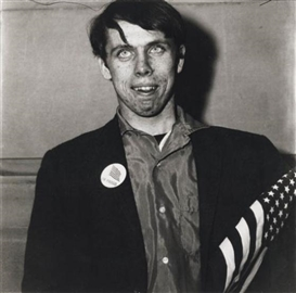 Diane Arbus, Neil Selkirk, Patriotic Young Man with a Flag, N.Y.C., 1967