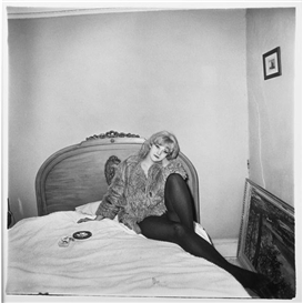 Diane Arbus, Girl in Coat Lying on Her Bed, N.Y.C