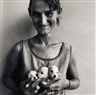 Roger Ballen, WIFE OF ABATTOIR WORKER HOLDING THREE PUPPIES, ORANGE FREE STATE, 1994
