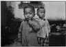 Mary Ellen Mark, Young Boy with Mickey Mouse Ears Yunnan Province China
