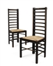 Charles Rennie Mackintosh, PAIR OF EBONISED OAK LADDER BACK CHAIRS