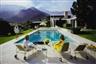 Slim Aarons, POOLSIDE GOSSIP : LITA BATON, NELDA LINS AND HELEN DZO DZO AT RICHARD NEUTRA-DESIGNED HOUSE OF EDGAR KAUFMAN, PALM SPRINGS