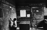 Bruce Davidson, Child at Blackboard in a Schoolroom, Selma, Alabama